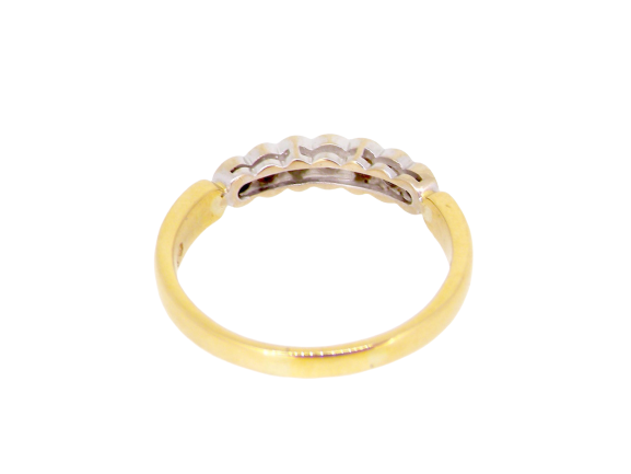 An 18 carat gold diamond eternity ring