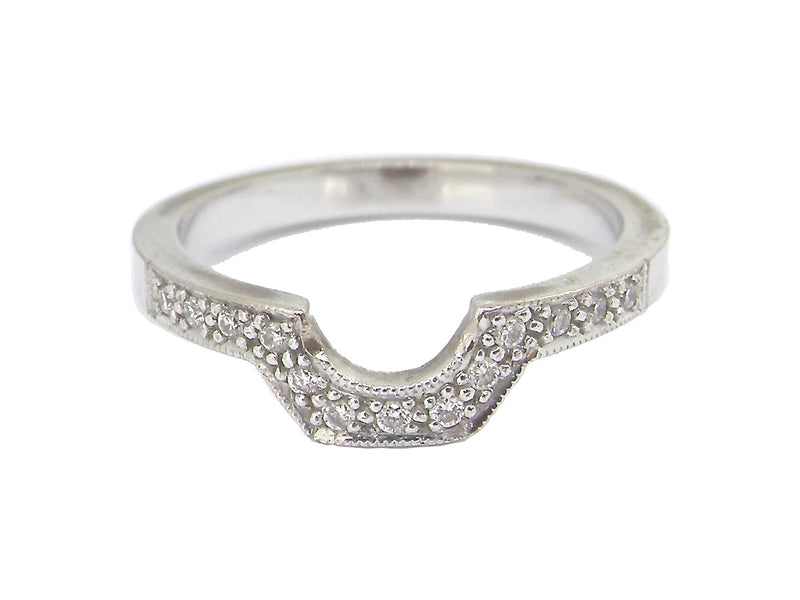 A white gold shaped diamond eternity ring