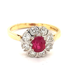 A fine ruby and diamond cluster ring