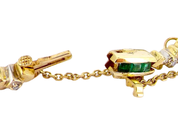 An emerald and diamond line bracelet