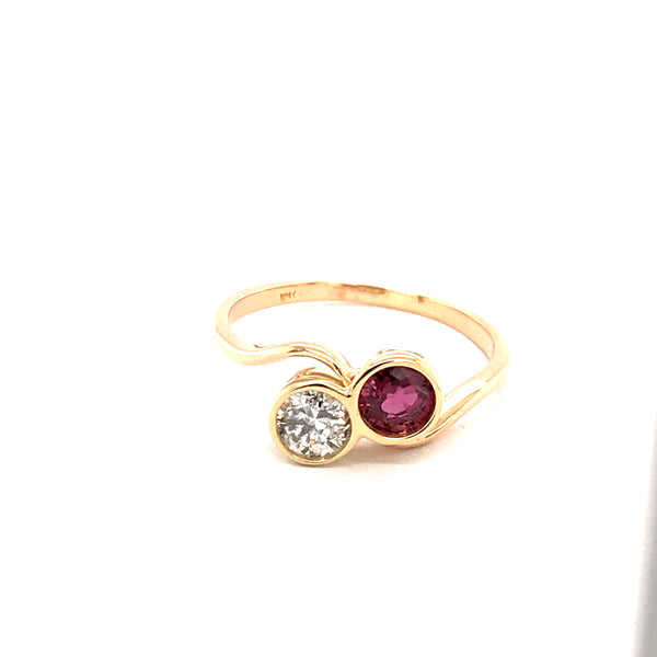 A vintage ruby and diamond two stone toi et moi ring