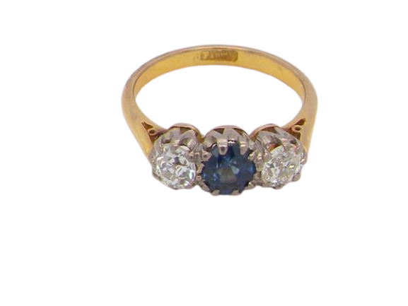 A classic sapphire and diamond trilogy ring