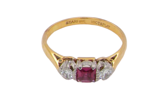 A classic three stone ruby and diamond ring
