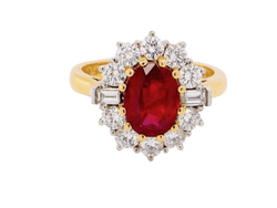 A fabulous ruby and diamond cluster ring