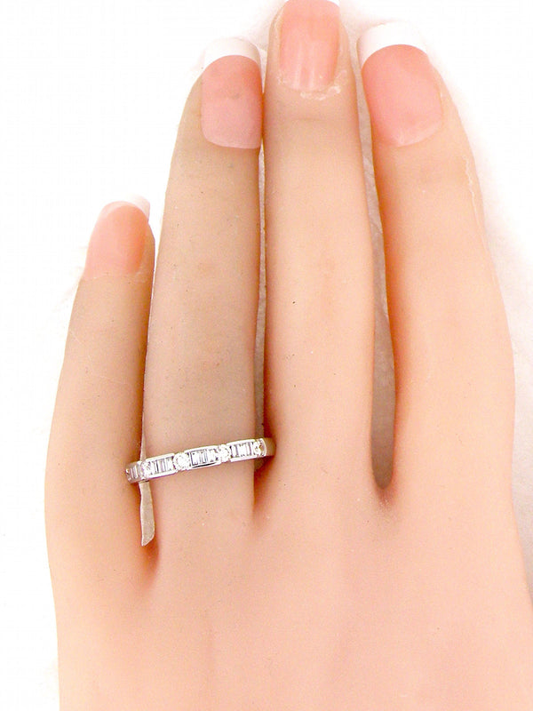 AN 18 CARAT WHITE GOLD HALF HOOP DIAMOND ETERNITY RING