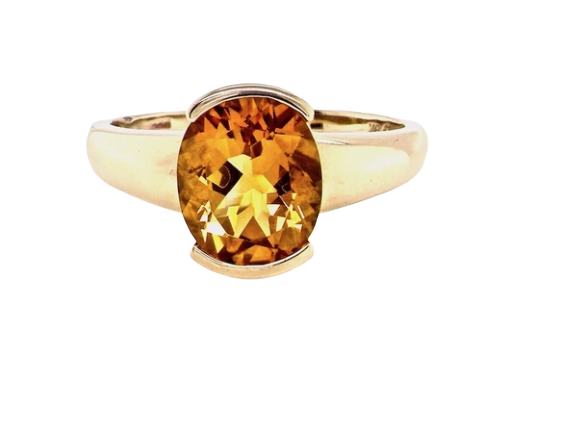A yellow citrine dress ring