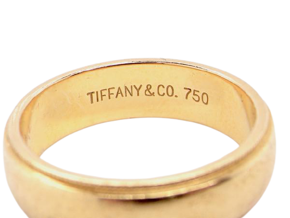An 18 carat gold Tiffany wedding ring