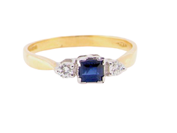 An 18 carat gold diamond and sapphire trilogy ring