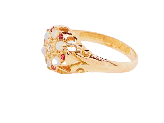 An 18 carat gold opal, diamond and ruby cluster ring