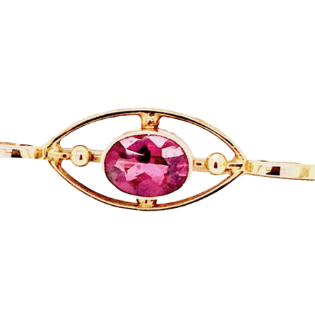 A pretty almandine garnet bar brooch