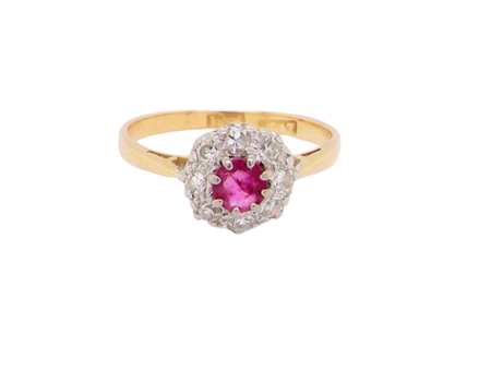 A traditional ruby and diamond cluster ring
