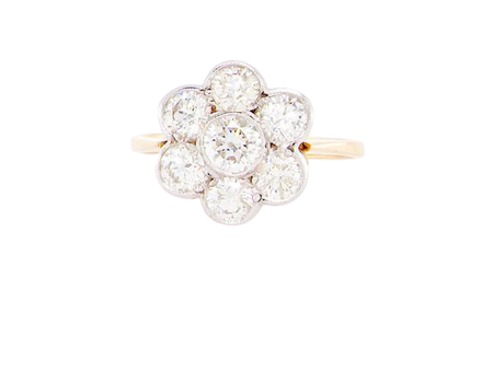 A vintage diamond daisy cluster ring