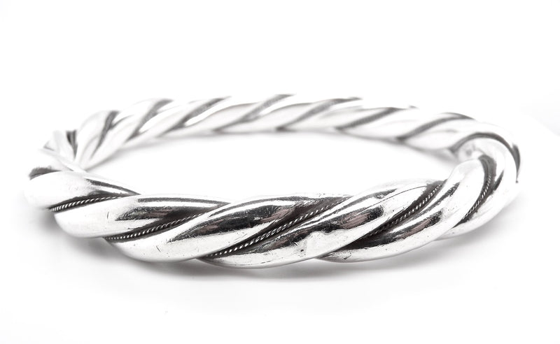 A heavy silver  twisted rope style bangle