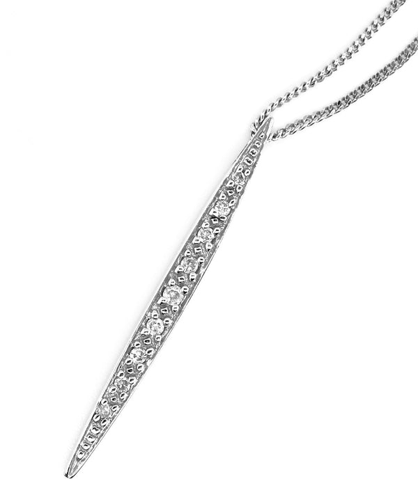 A 9 carat white gold arrow shaped diamond pendant