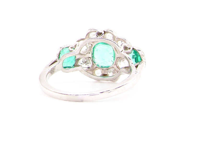 An outstanding French origin emerald and diamond cluster ring