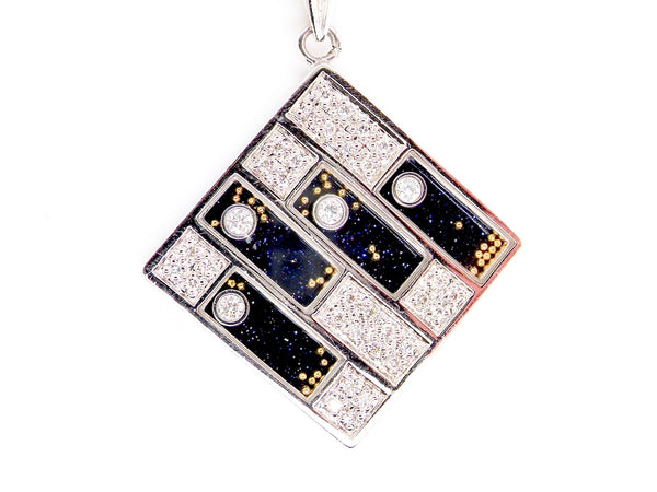A diamond and blue goldstone pendant