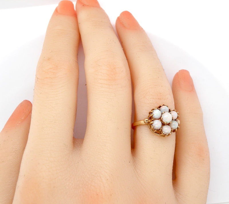A 9 carat gold opal cluster dress ring