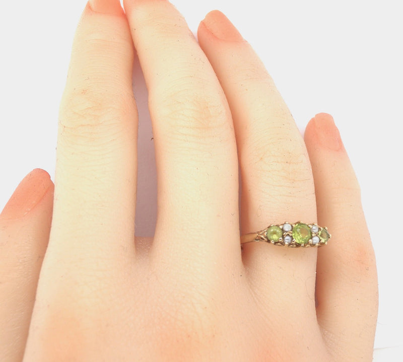 A peridot and pearl vintage style dress ring