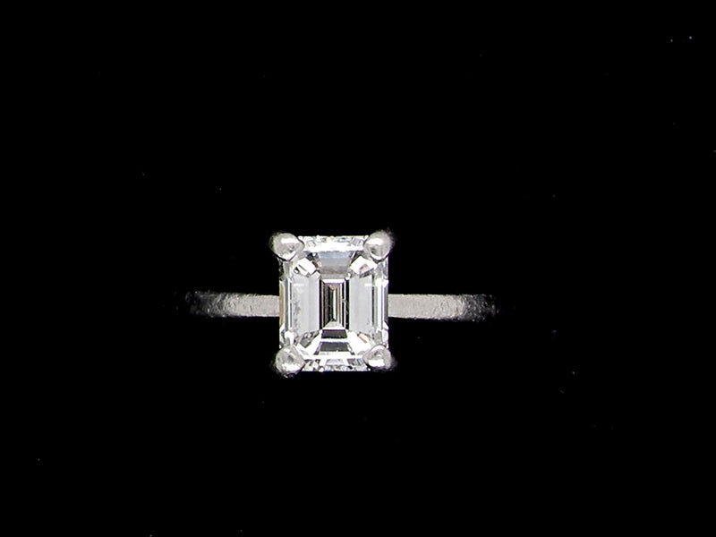 A .80 carat emerald cut solitaire diamond ring