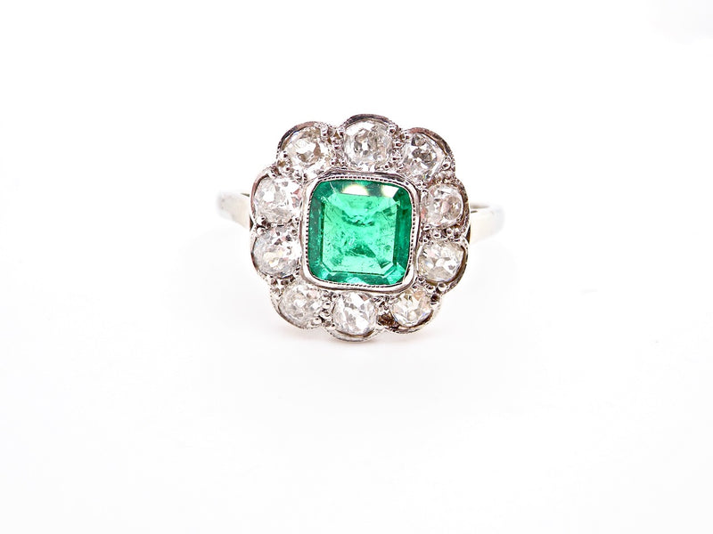 An antique emerald and diamond cluster ring