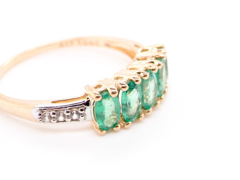 A 9 carat gold emerald and diamond ring
