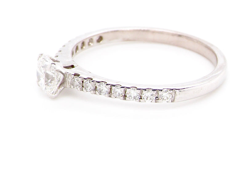 An 18 carat white gold solitaire diamond ring