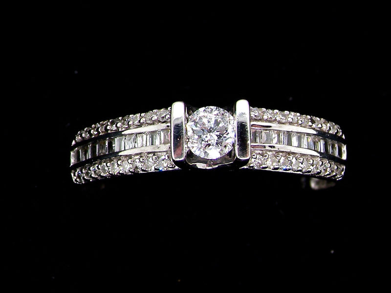 A fancy white gold diamond solitaire ring