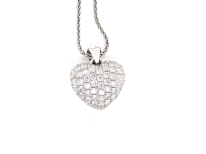 An 18 carat white gold diamond heart pendant
