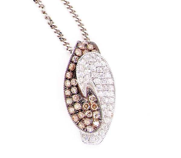An 18 carat gold two colour diamond pendant