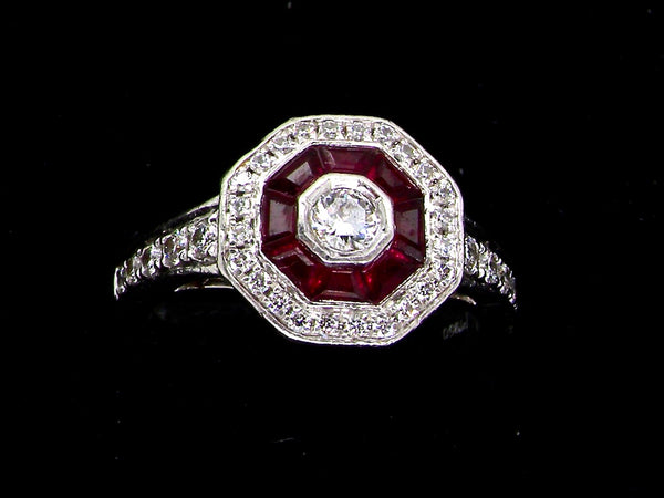 A platinum ruby and diamond halo cluster ring