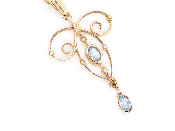 A 9 carat gold aquamarine and pearl pendant