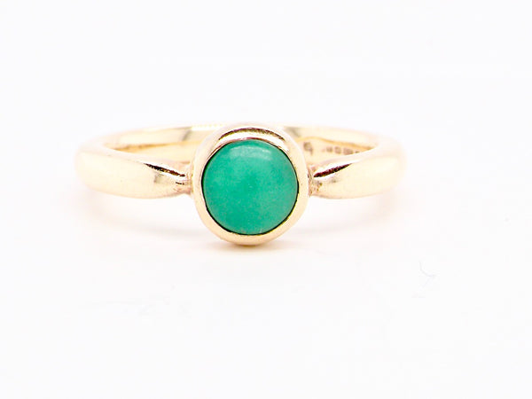 A 9 carat gold modern turquoise dress ring