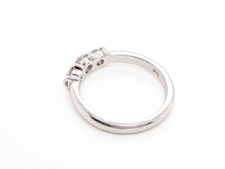 A platinum three stone diamond ring
