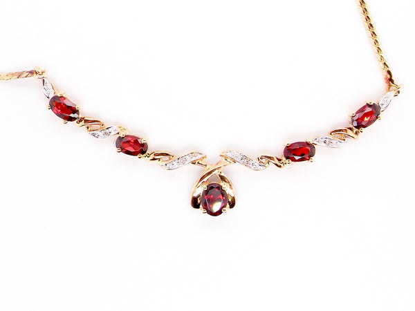 A garnet and diamond feature necklace