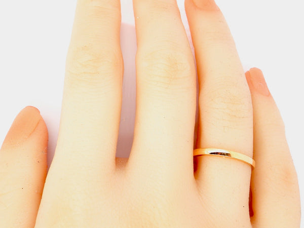 A narrow 2mm 22 carat gold wedding ring
