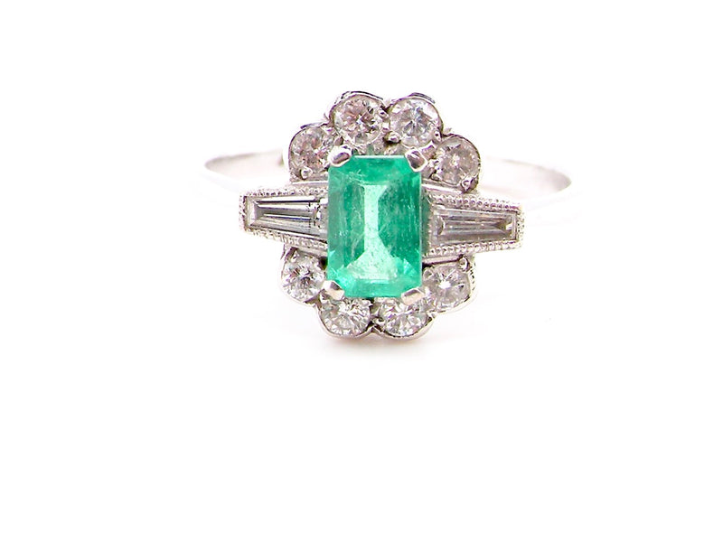 An Art Deco emerald and diamond cluster ring