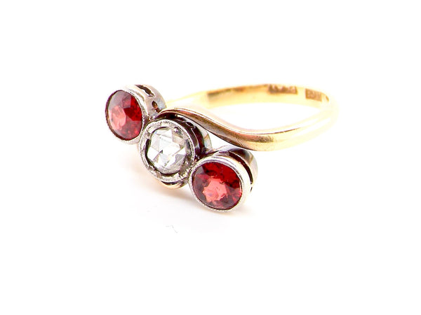 A vintage garnet and diamond ring