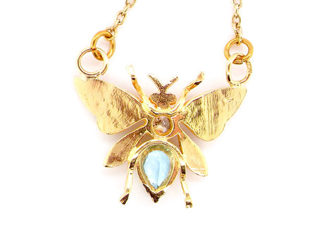 An 18 carat gold gem set butterfly pendant