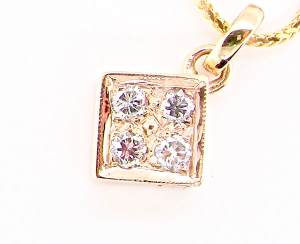A 9 carat gold diamond pendant