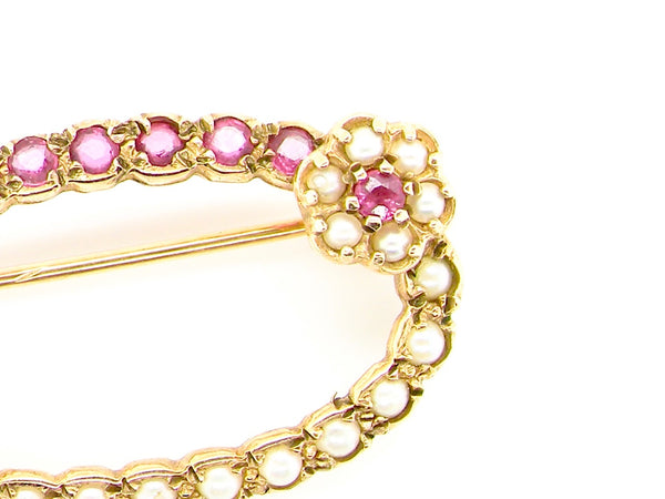 A 9 carat gold pearl and ruby brooch
