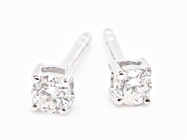 A pair of 0.10 carat white gold diamond earrings