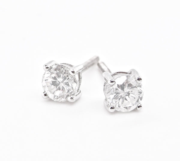 A pair of half carat diamond stud earrings- NEW
