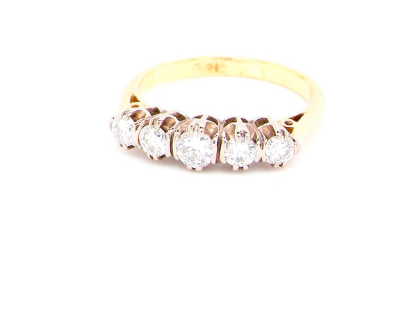 A vintage five stone diamond ring