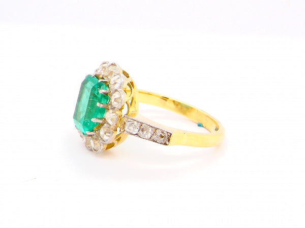 A fine vintage emerald and diamond cluster ring