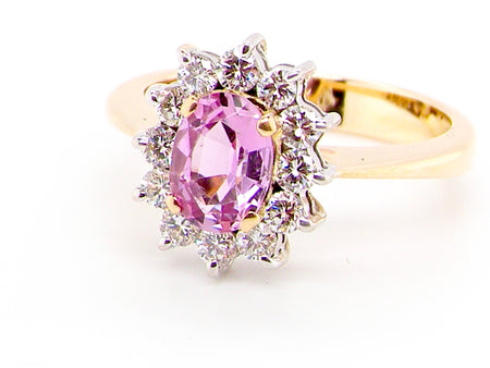 A pink topaz and diamond cluster ring
