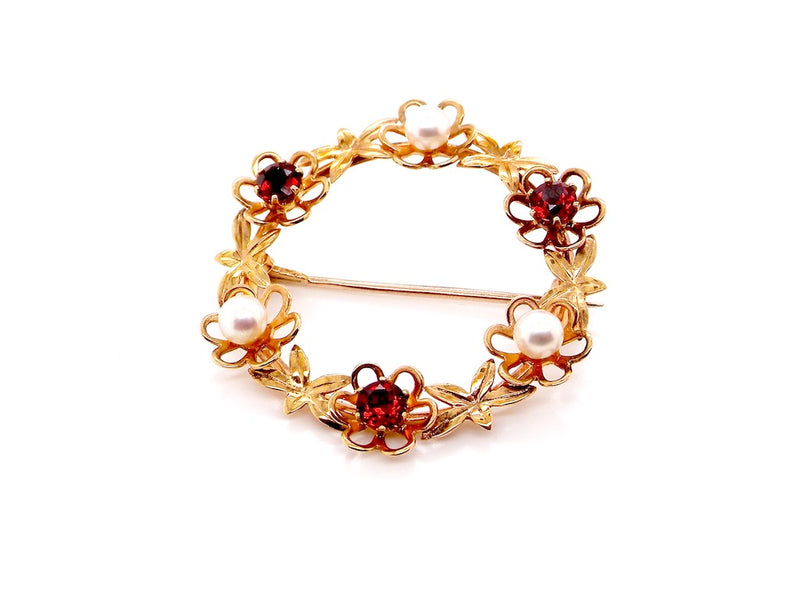 A 9 carat gold garnet and pearl brooch