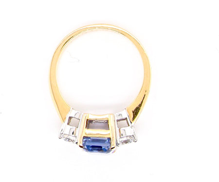 A fine three stone sapphire and diamond ring