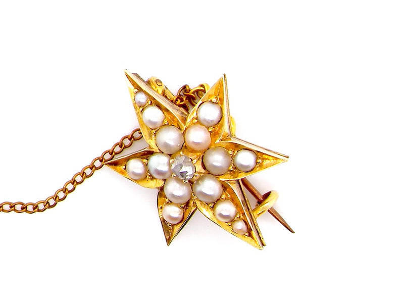 A vintage star shaped pearl and diamond brooch