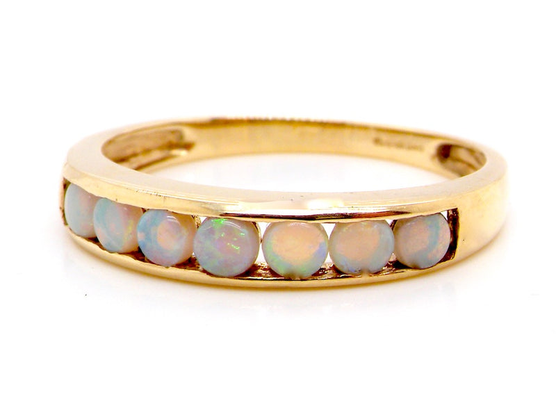 A 9 carat gold opal eternity ring