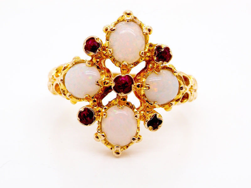An opal and ruby fancy cluster ring